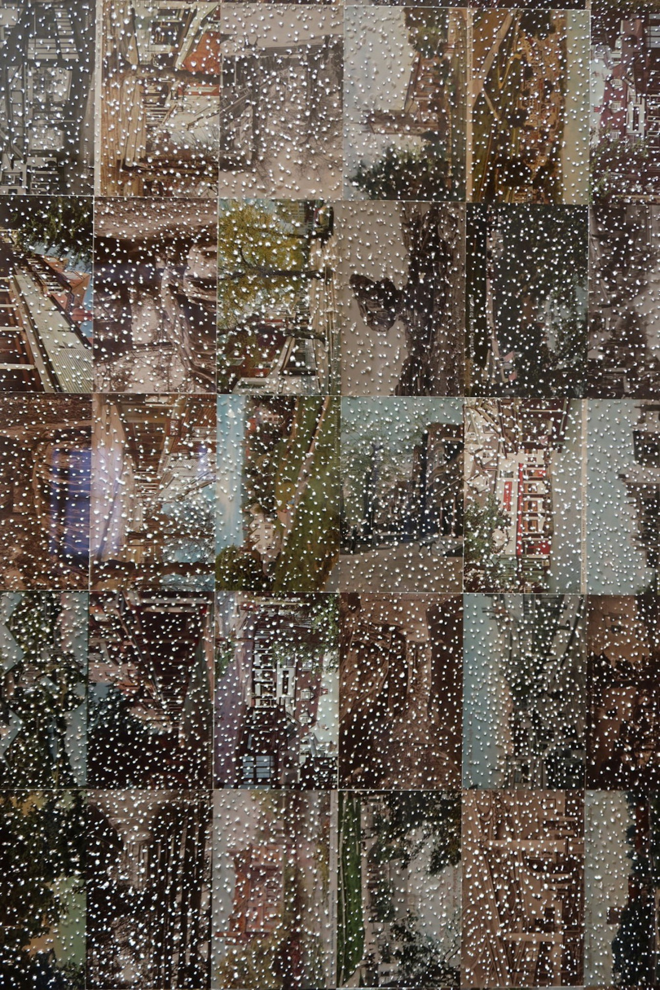 'Greetings from Tunbridge Wells', made from postcards of the town with a pin pricked surface.
