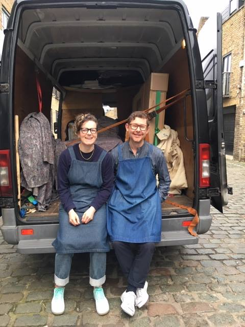 Portrait of Tracey Rowledge and David Clarke sitting in the back of a van