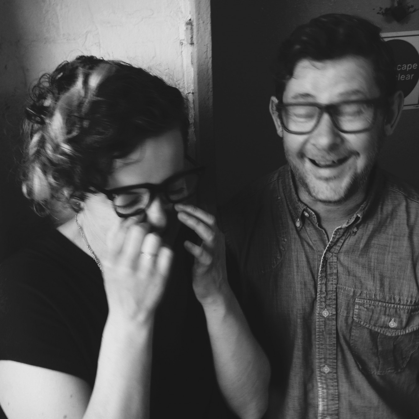Portrait of Tracey Rowledge and David Clarke laughing to much during a photo shoot