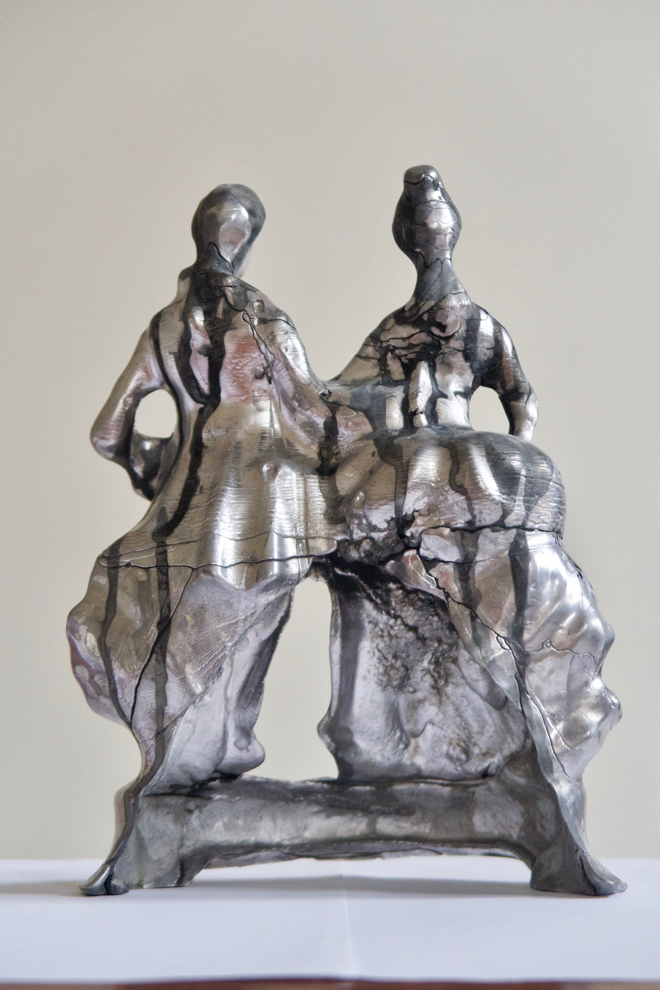 Image of a conjoined couple. Originally slipcast ceramic used as a one off mould. Now pewter only, as the ceramic was smashed off. Patination fluid simply dripped over the figures