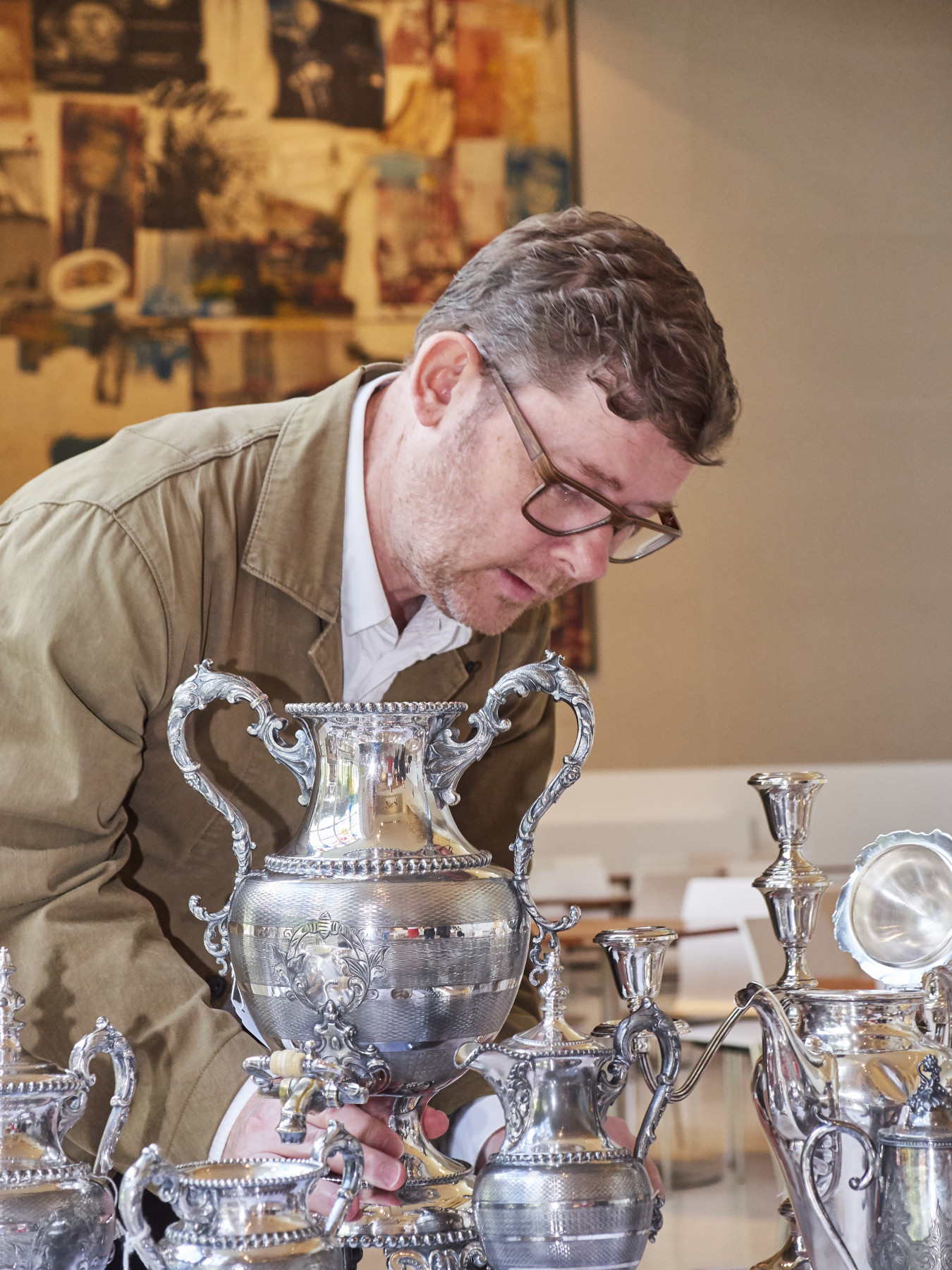 Image of David Clarke in Dallas Museum of Art looking at silverware donated to the 'Family Matter' project.