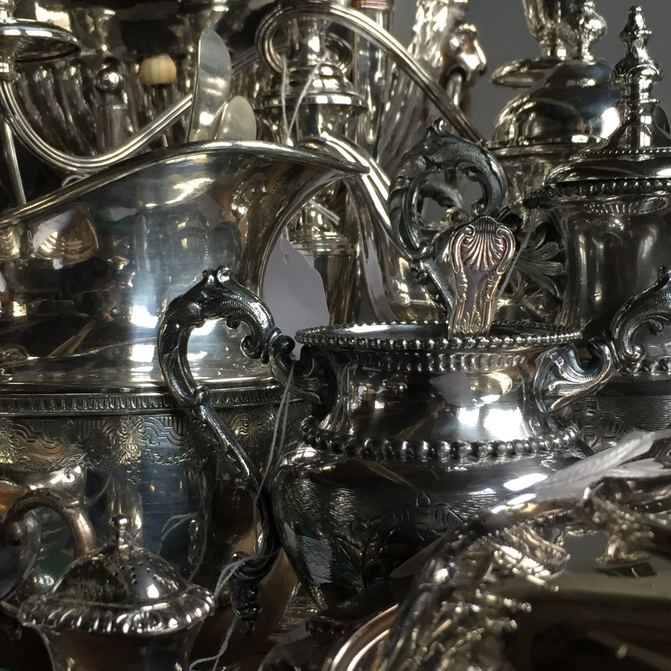 Image detail showing a range of second hand donated polished silverware.