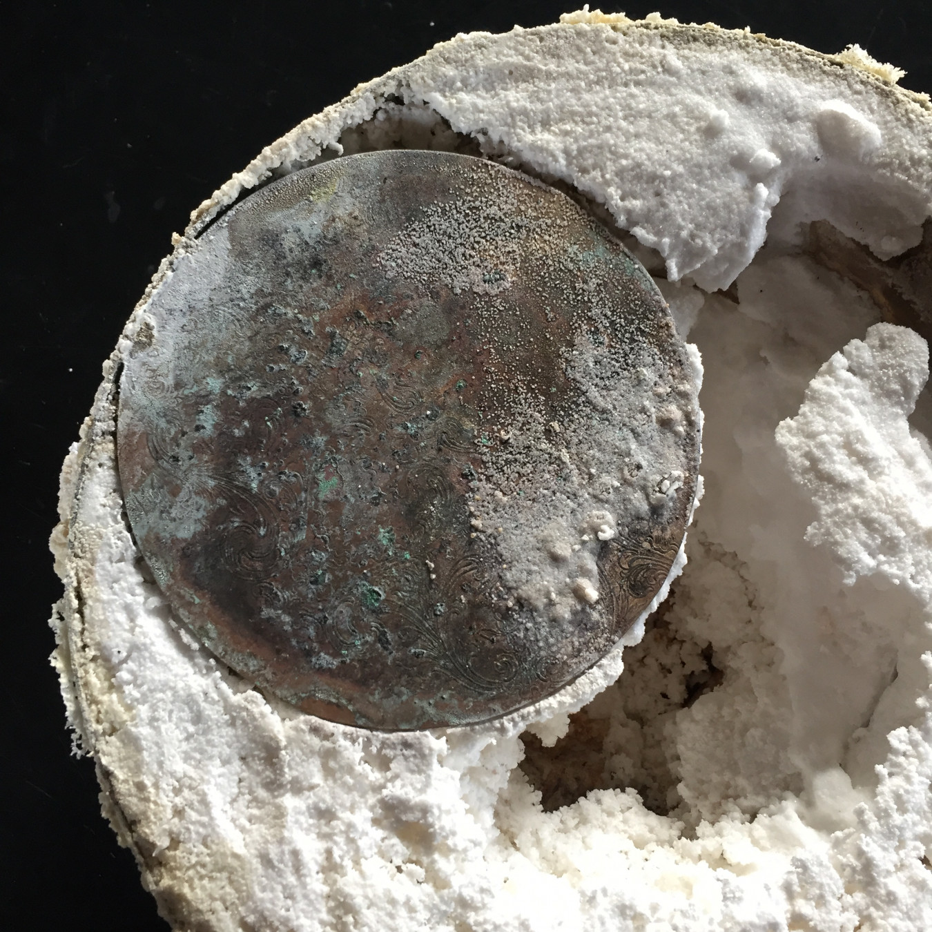 Image of silver donations that have been baked with common table salt to create large salt cellar.