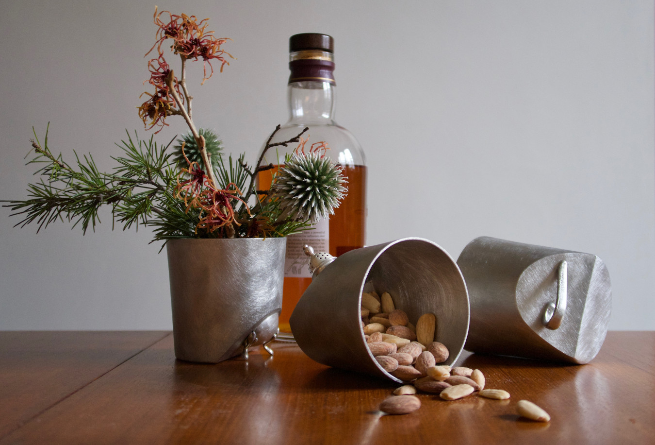 Image of pewter pots with a vintage element added, holding snacks and flowers given to donors as a gift.