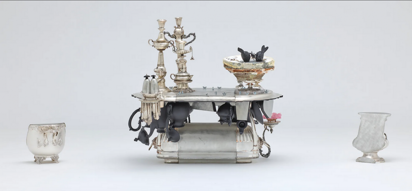 Image of the finished centrepiece, 'Family Matter' made by David Clarke for the Dallas Museum of Art. A large centrepiece including three candlesticks, a salt cellar and two 'sentinels', for protection.