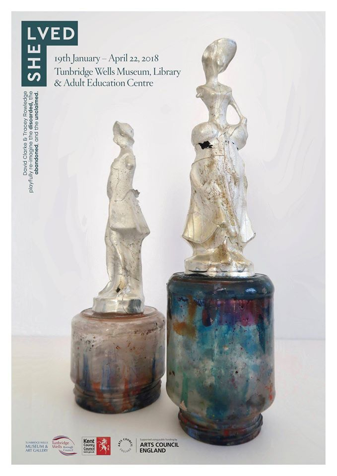Shelved exhibition poster showing 2 cast figures standing on painted jam jars.
